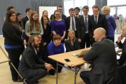 CHOIR CHOICE: Musical Director Russell Scott, seated, talks to Voices of Hope, a choir from Newcastle which was one of the hopefuls auditioning for Godspell at Darlington Education Village. Picture: ANDY LAMB