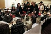 MONEY BAGS: Auction goers bag their bags at the Hall Garth Hotel. Picture: STUART BOULTON
