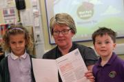 OFSTED: Audrey Meredith, six, and Isaac Purchase, five, celebrate with West Park Academy principal Catherine Thompson after a successful Ofsted report