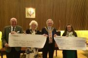 GENEROSITY: Councillor Lee and his wife Ruth hand over the cheques to Jackie Firth, from Butterwick Hospice, and Jock Kelso, from Phoenix House.
