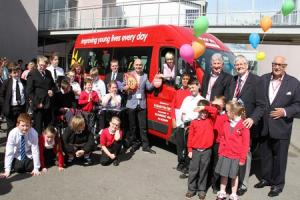 Boxing champ hands over coach keys to children's charity